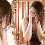 girl-looking-in-mirror crying